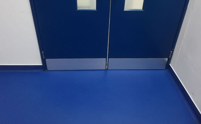 Picture showing the doorway and completed installation of resin flooring
