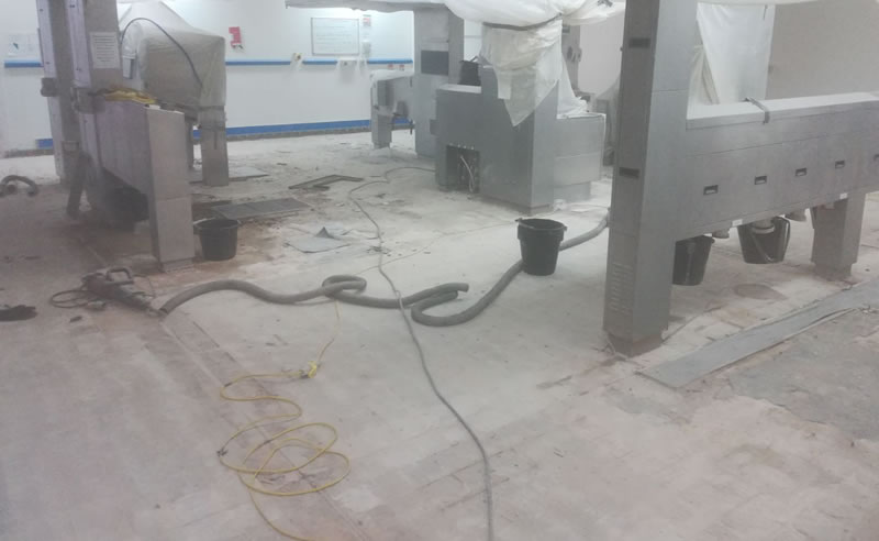 Picture showing the completion of removing the old tiles before the new resin flooring was installed