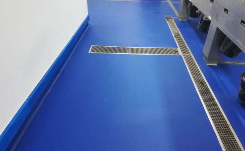 Finished installation of resin flooring showing the corridor