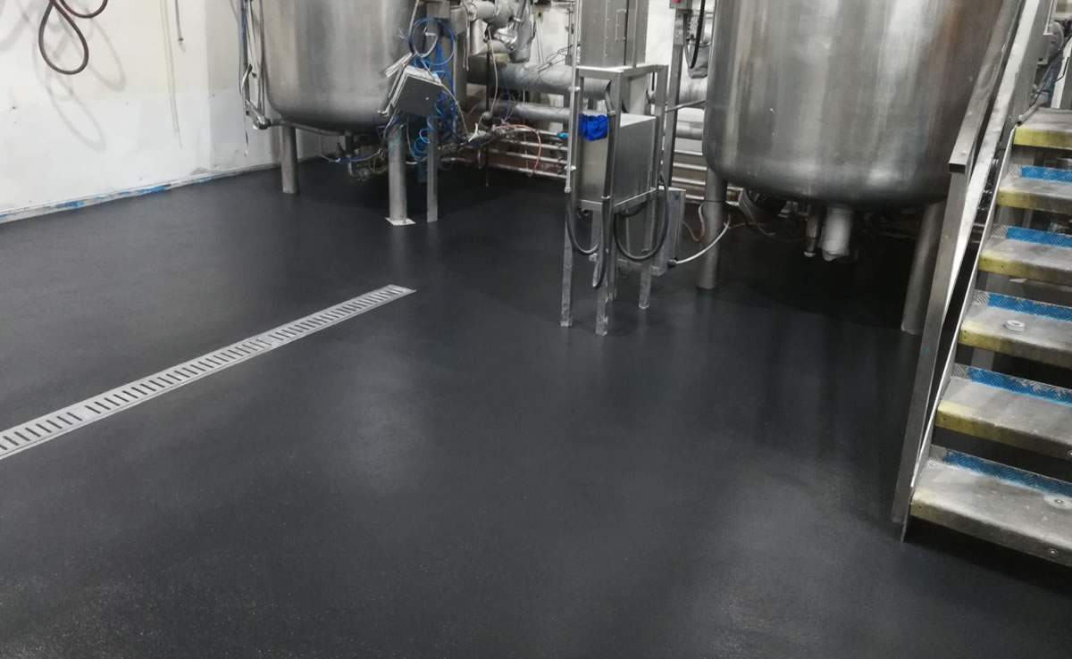 Completed installation of heavy duty polyurethane screed in charcoal for a health and beauty manufacturer