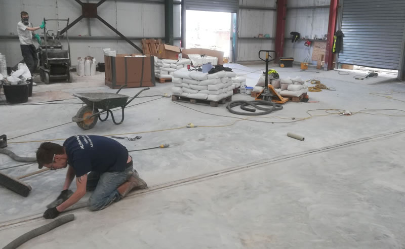 continuing preparation of the concrete floor for the resin flooring screed