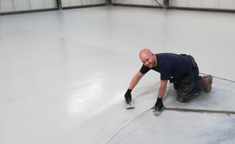 enjoying his work installing the heavy duty polyurethane screed