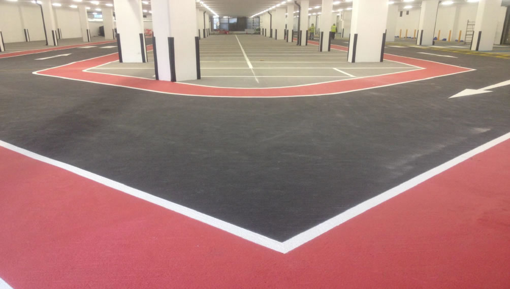 red and black resin flooring used in a car park