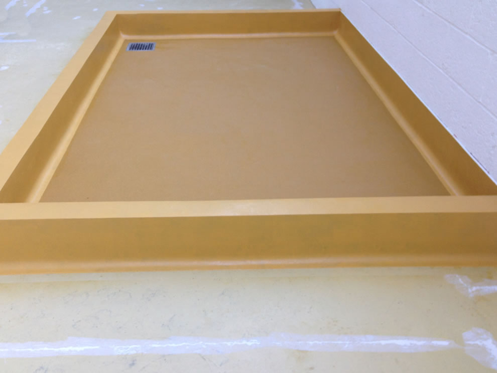 industrial resin flooring photo showing the coving detail on a chemical bund