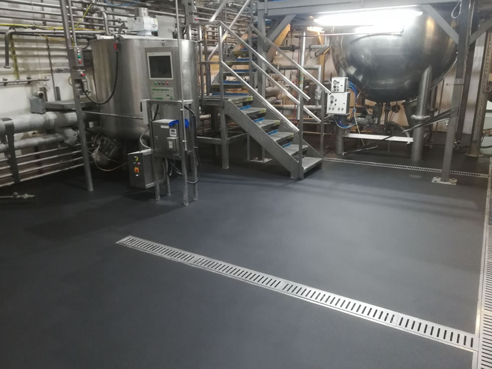 industrial resin flooring photo showing the drainage systems installed