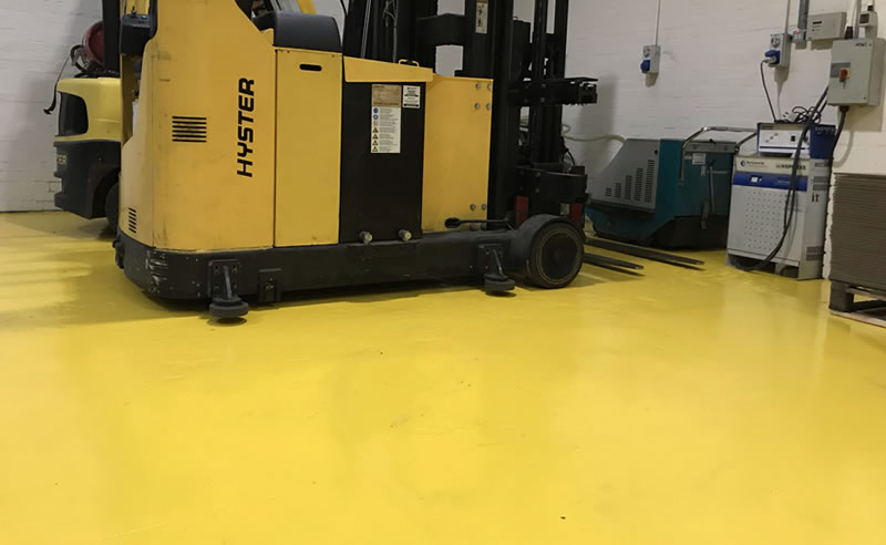 installing yellow demarcation at a chemical warehouse for health and safety