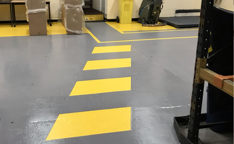 installing yellow demarcation in a chemical warehouse for foot traffic