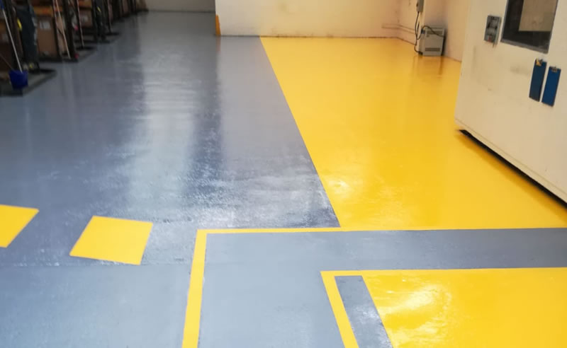 installing yellow demarcation in a chemical warehouse for fork lift traffic