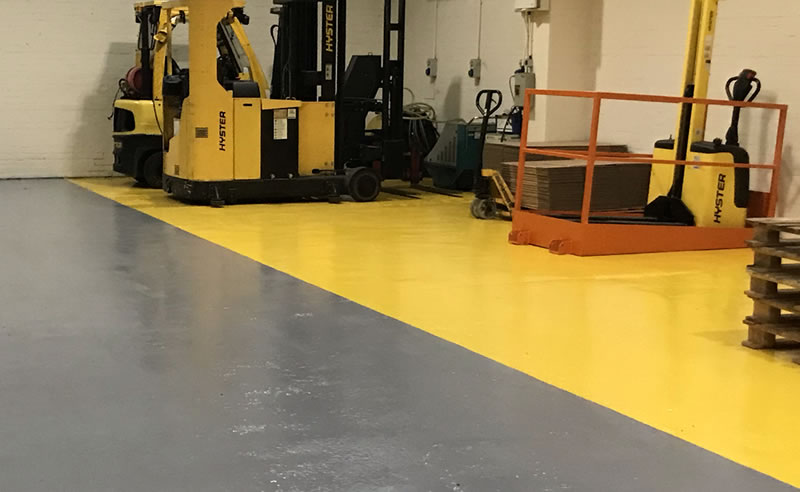 installing yellow demarcation in a chemical warehouse for health and safety