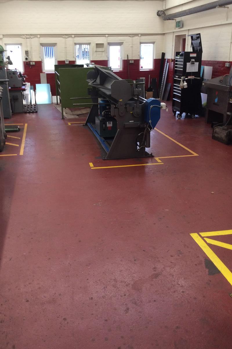Before work started on installing an epoxy slip resistant coating to transport workshop