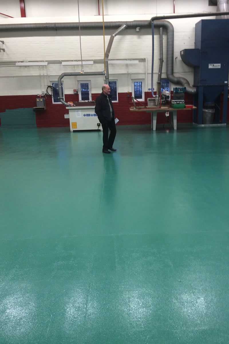Finished installing an epoxy slip resistant coating in a transport workshop for fire and rescue