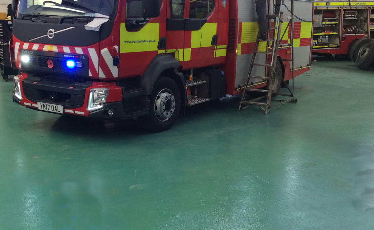 Installing epoxy slip resistant coating to west yorkshire fire and rescue transport workshop