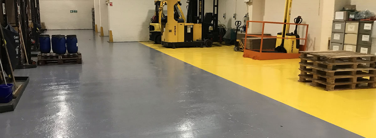 Resin Flooring Specialists showing completed floor for chemical distribution warehouse