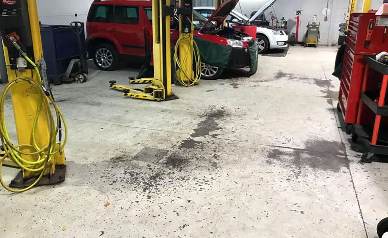 picture before workshop garage floor at skoda in bradford was refurbished