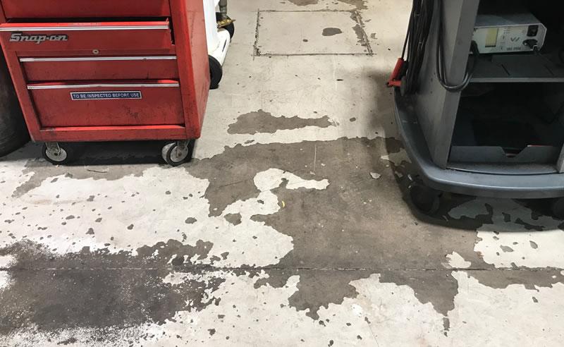 picture of worn away paint before workshop garage floor at skoda in bradford was refurbished