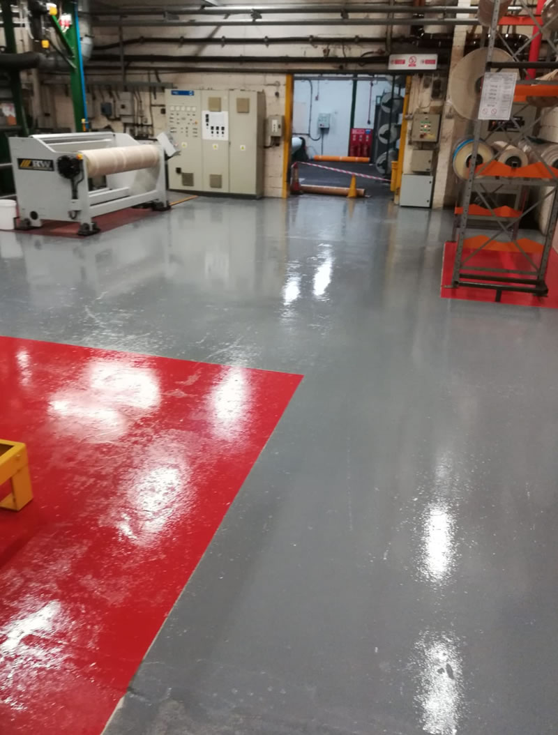 completed resin flooring for a transmission belt manufacturer in red and grey
