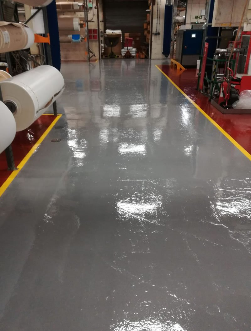 completed resin flooring in grey colour for a transmission belt manufacturer