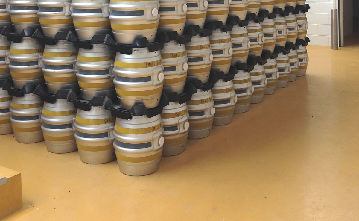 food grade flooring example at a brewery with barrels stacked