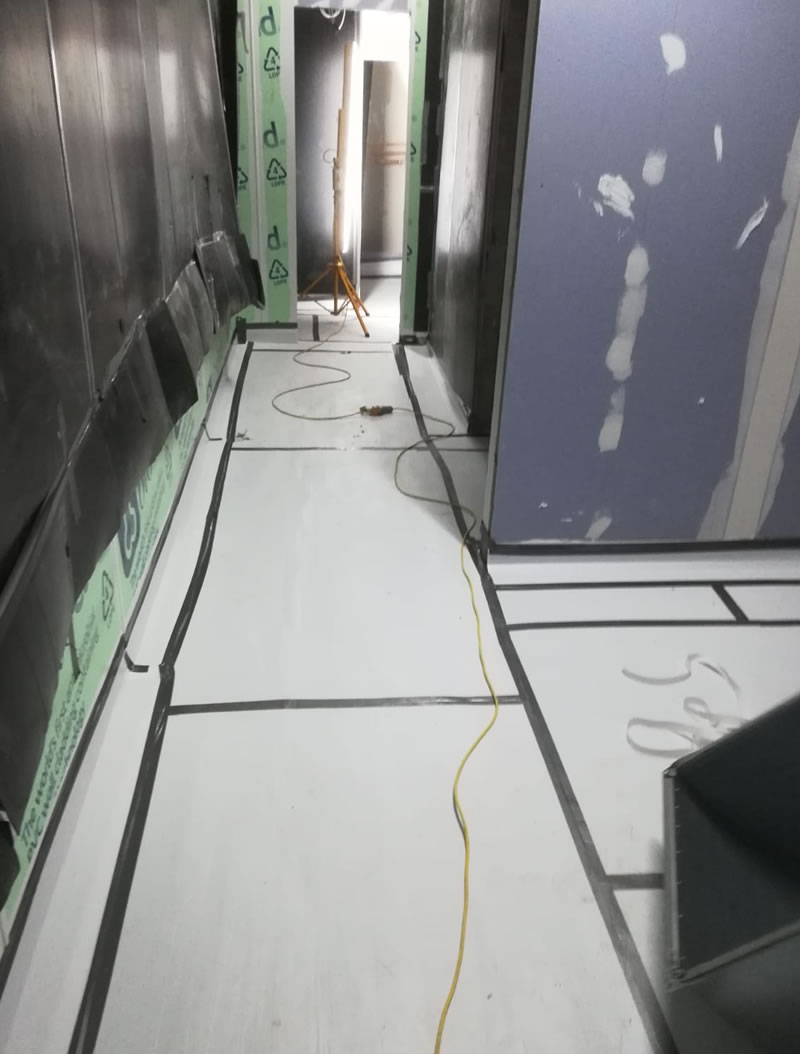 photo after the pu resin flooring was installed and covered with protective correx boards
