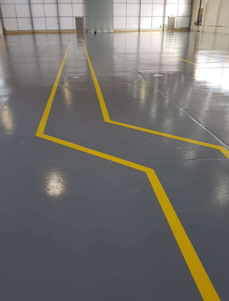 repaired warehouse floor project at an old aircraft hanger