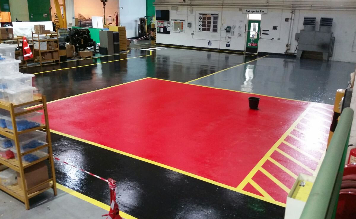 workshop flooring example in black and red colours and yellow demarcation