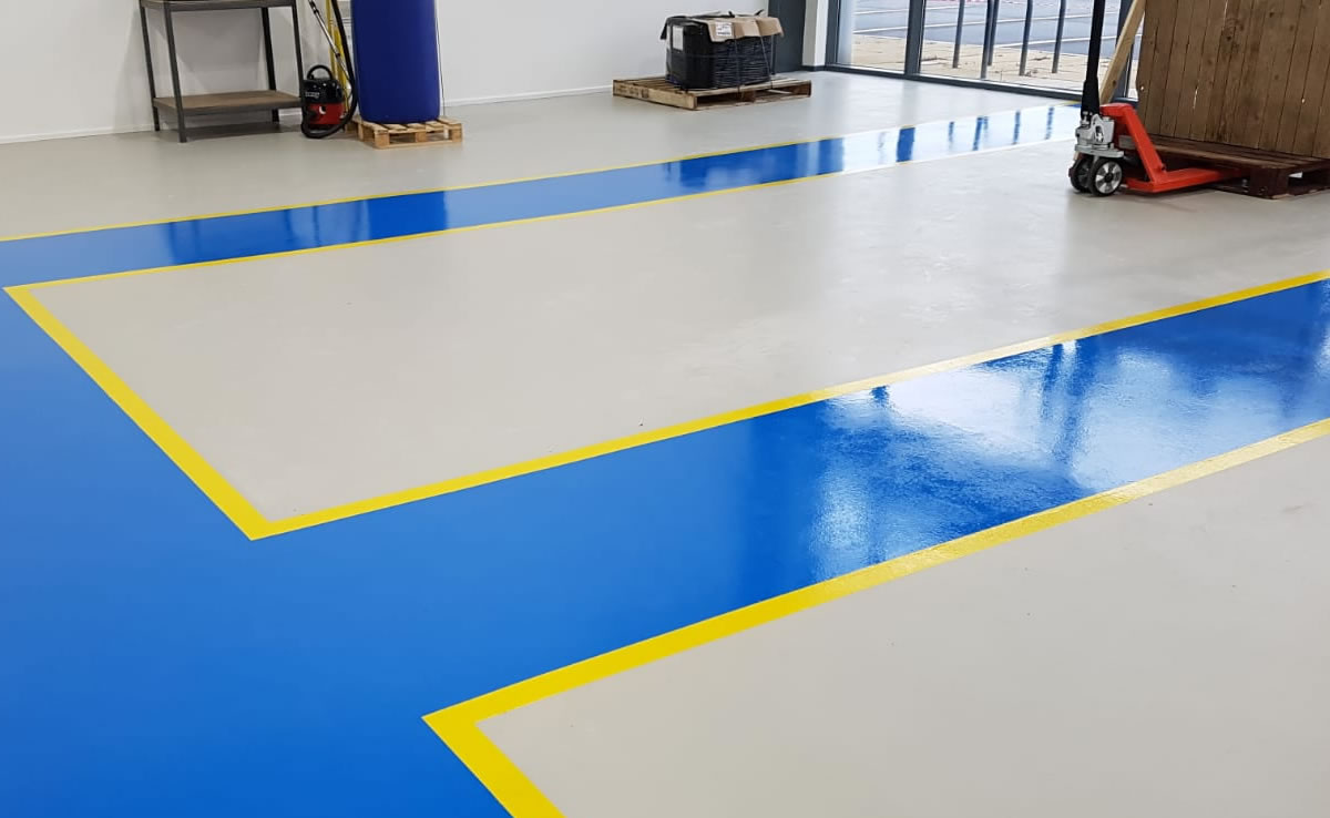 workshop flooring in grey with blue pedestrian walkways