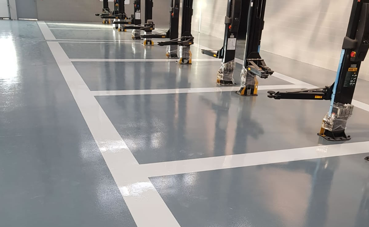 chemical resistant flooring for jaguar land rover car dealership in newcastle upon tyne