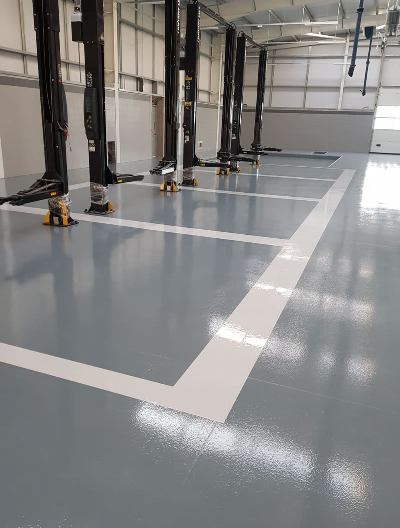 chemical resistant flooring with demarcation for jaguar car dealership in newcastle upon tyne