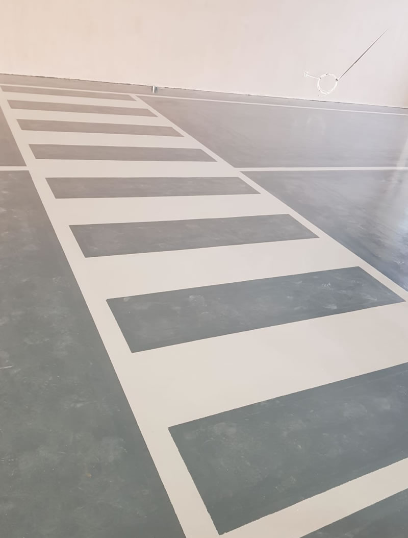resin floor installation which is chemical resistant and zebra crossing demarcation