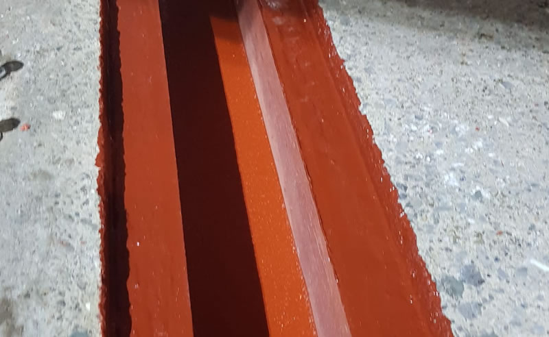 a close up picture of completed drainage at a chemical plant