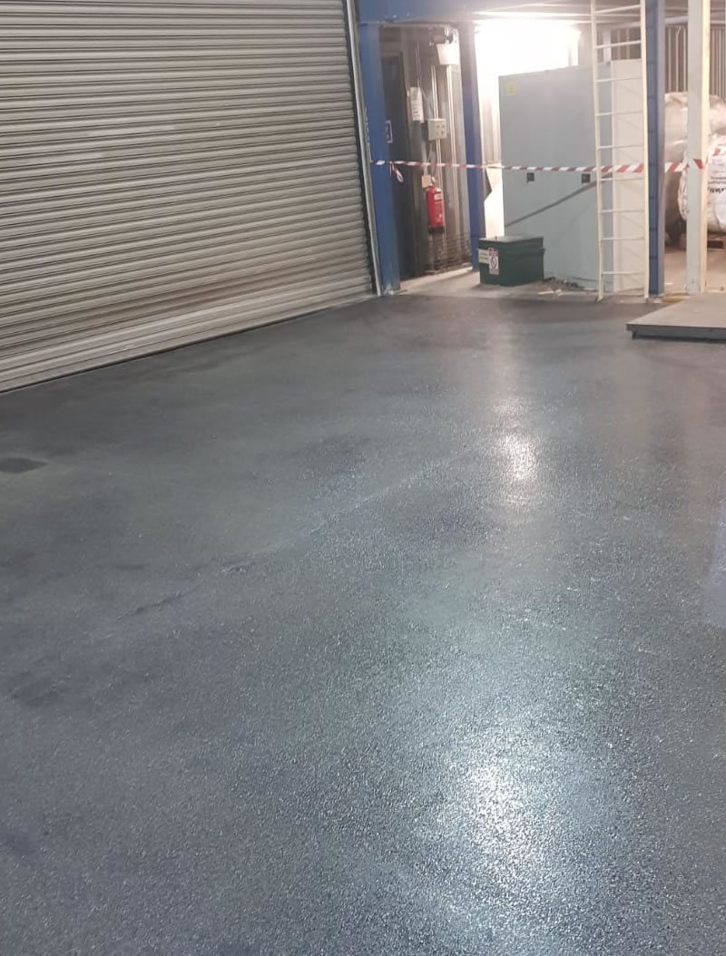 completed resin floor showing the vehicle entrance for a customer in hertfordshire