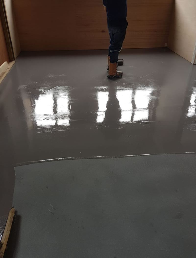 installing high build expoxy coating at a factory floor in yeovil somerset