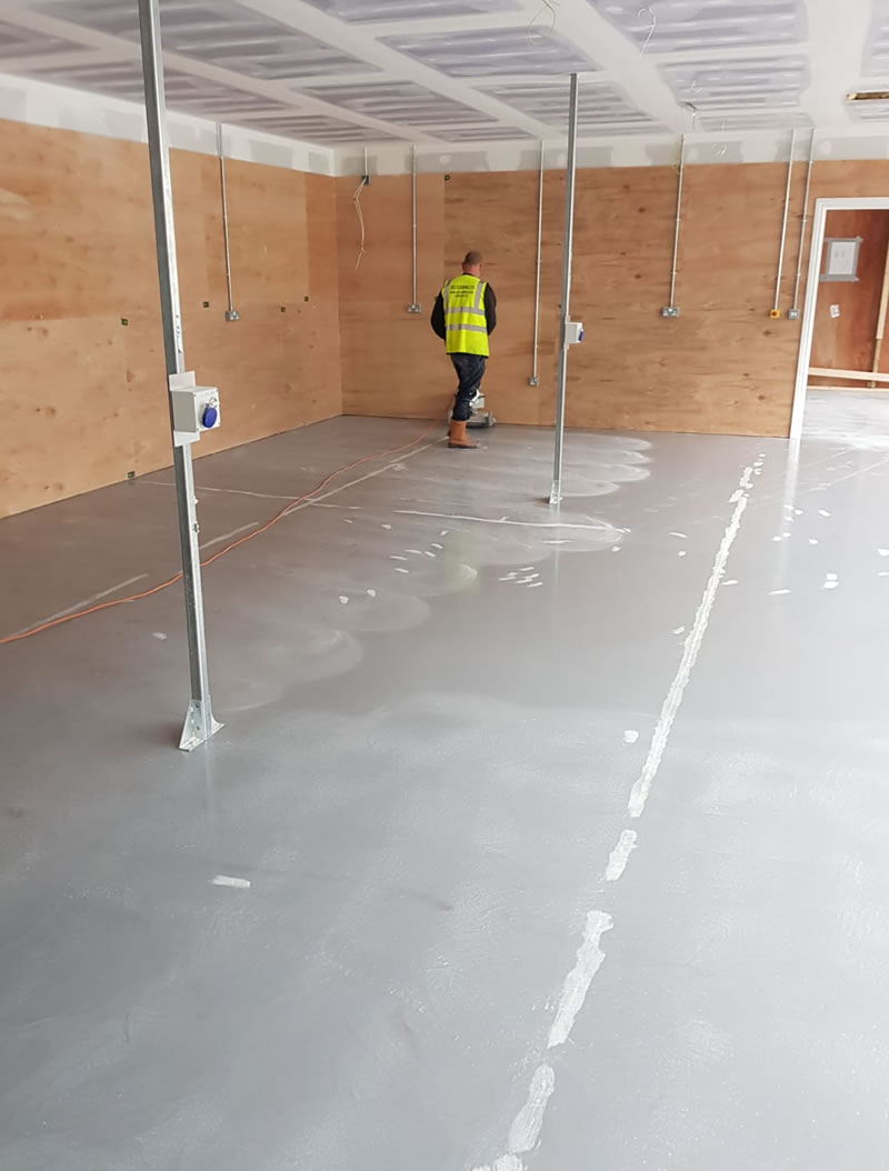 preparing the concrete floor for resin high build coating for a customer in somerset
