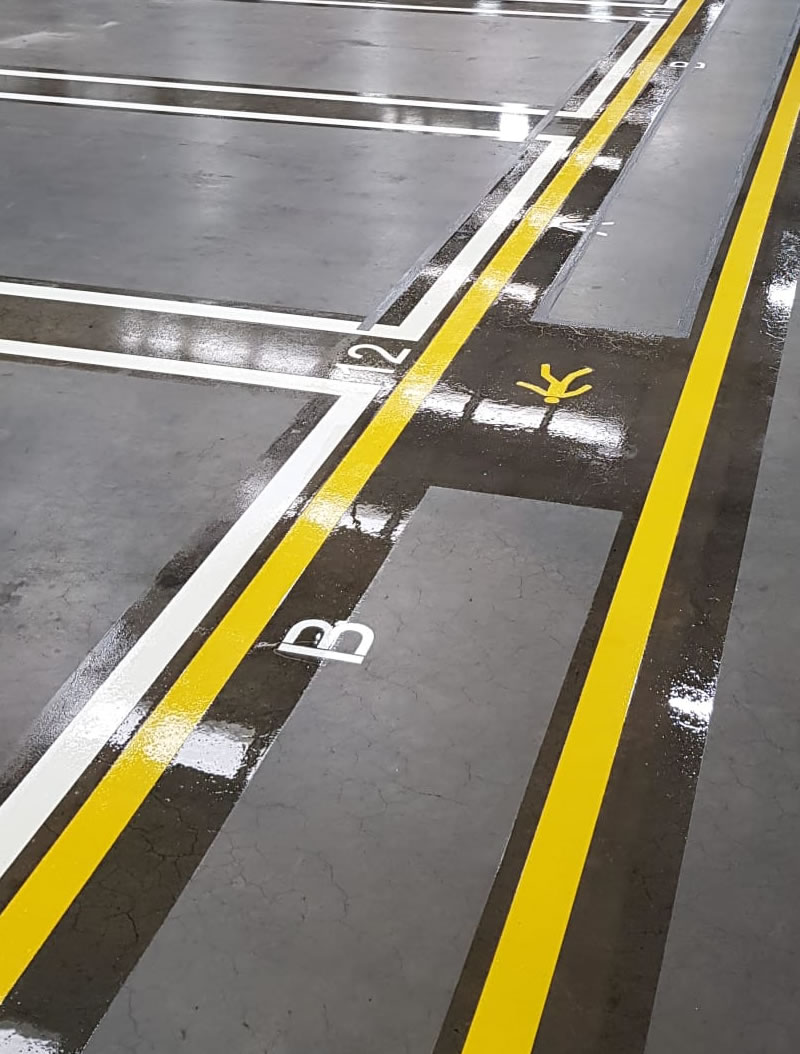 close up picture of yellow and white lines in a warehouse in doncaster
