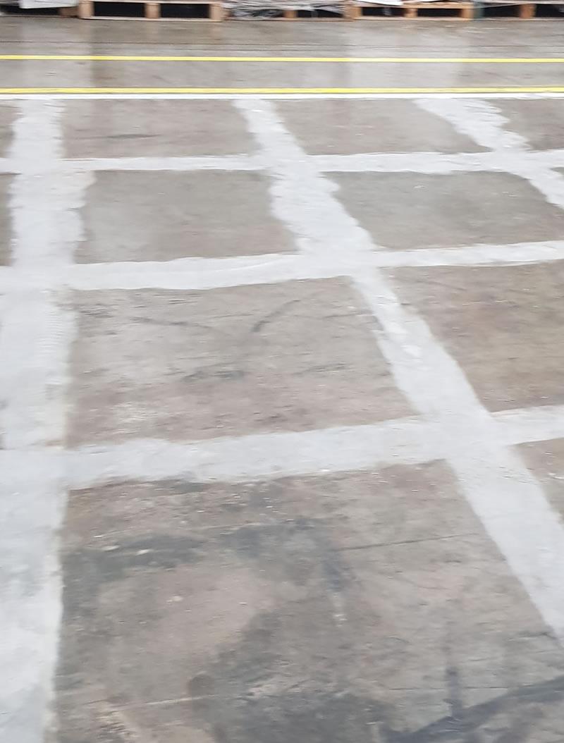 preparing warehouse concrete floor for demarcation in yellow