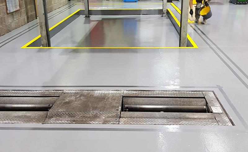 competing new flooring for a car garage workshop in bristol