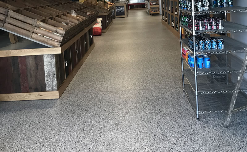 completed decorative flake flooring for a large farm shop in huddersfield