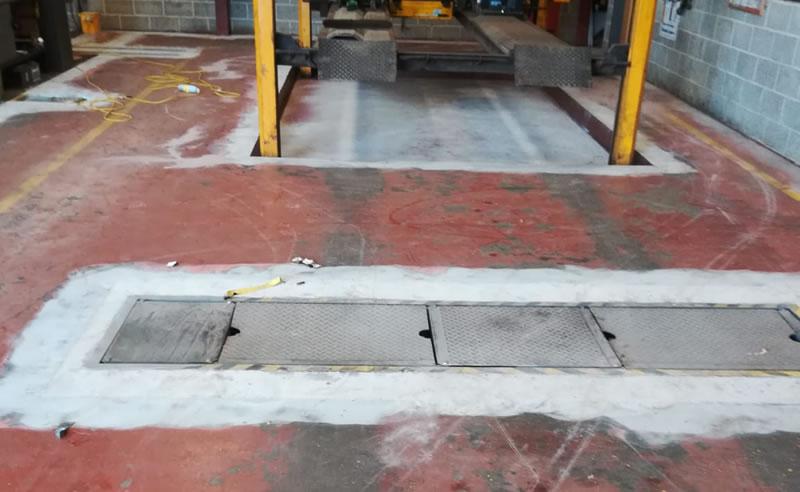 garage workshop floor before the new resin floor was laid