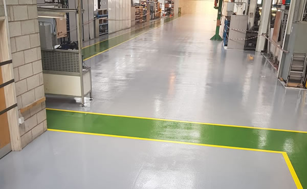 large workshop flooring project in grey and green demarcation