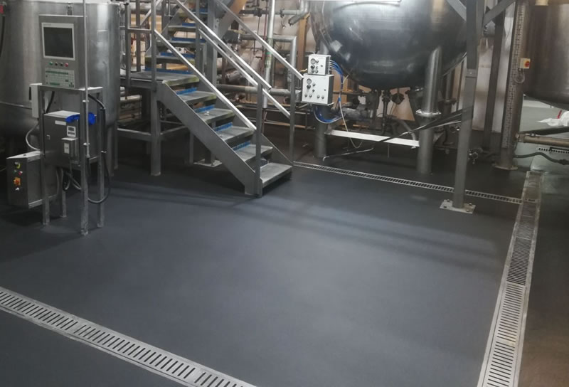 black floor with drainage system installed 2