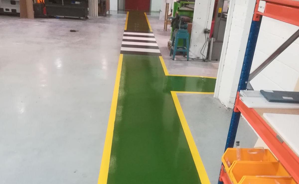 green demarcation for walkway in a workshop