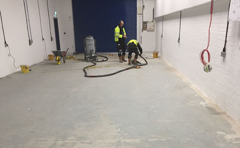 preparing concrete floor for resin coating to protect it