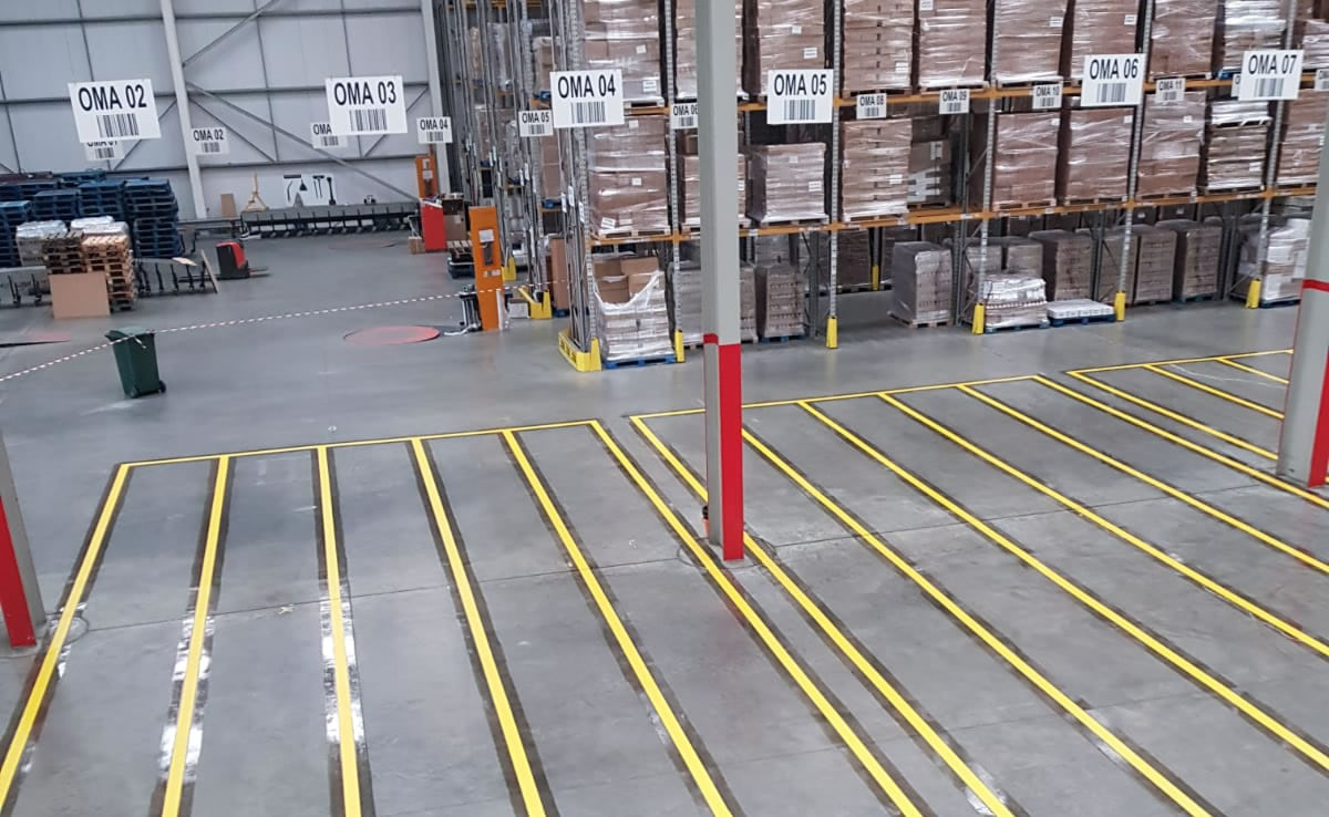 warehouse floor with yellow demarcation lines
