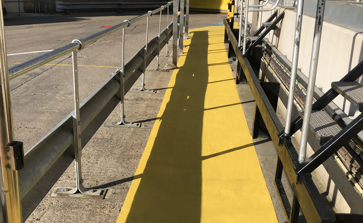 yellow non slip demarcation used outside a factory