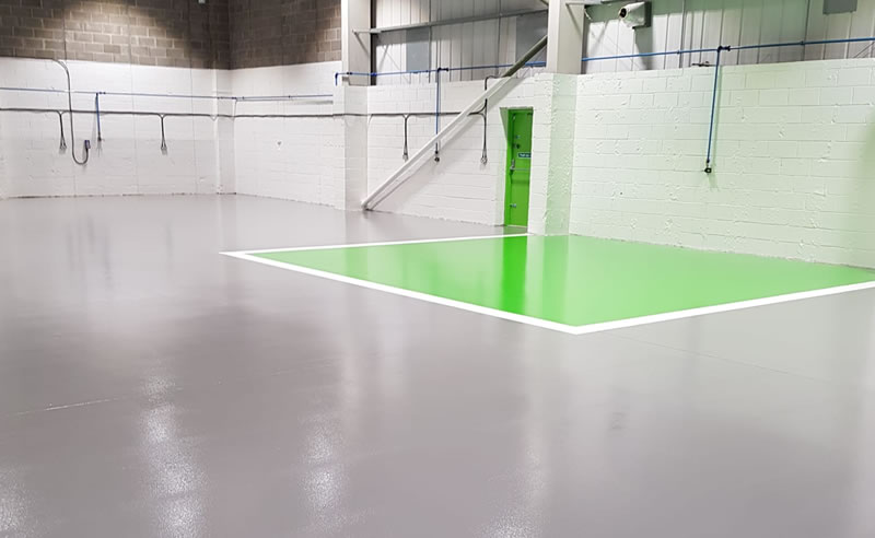 a repair centre in grey and green resin flooring
