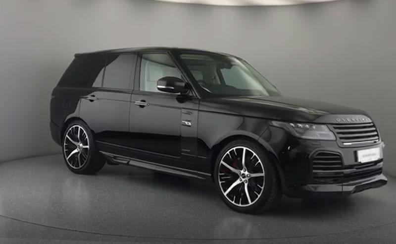 black car on showroom turn table
