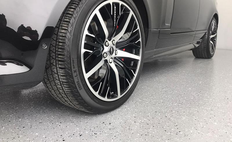car wheel sat on decorative flake resin flooring