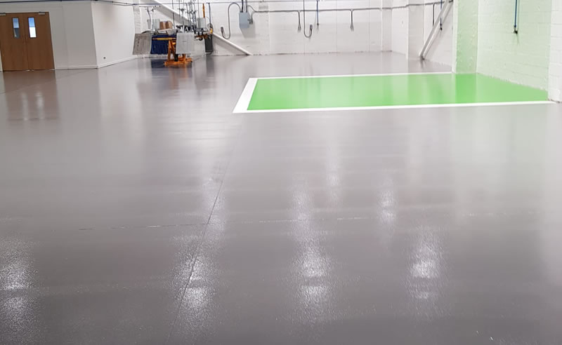 finished resin flooring for a motor vehicle repair centre in glasgow