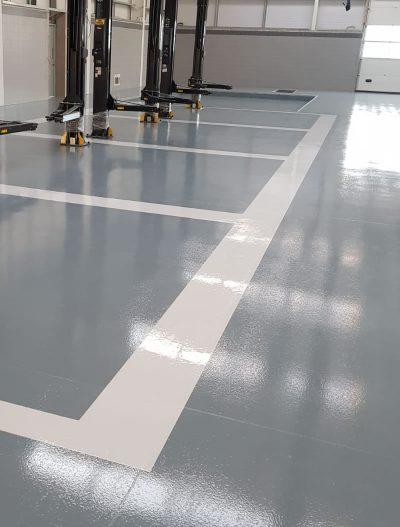 grey resin flooring for a car dealership