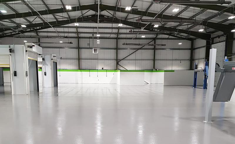 large motor vehicle repair centre in grey resin